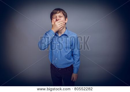 teenager boy of 10 years  European appearance sleepy, yawning,