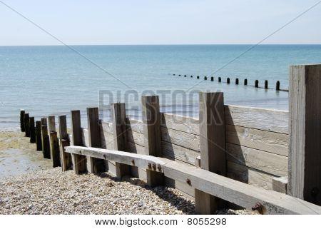 Wooden Groyne On Shingle Beach.
