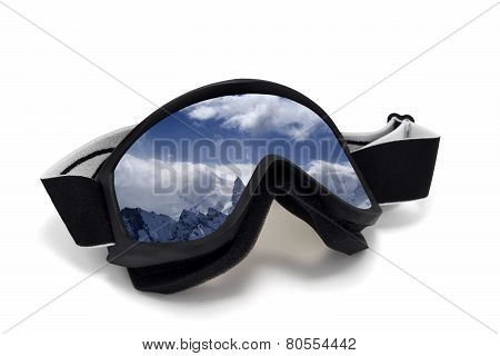 Ski Goggles With Reflection Of Cloudy Mountains