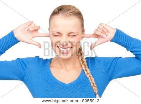Smiling Woman With Fingers In Ears