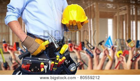 Construction worker with  tools in  new house. Renovation.