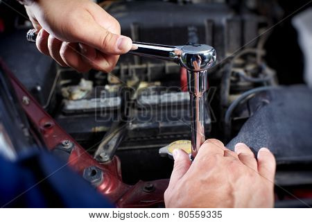 Mechanic working in auto repair garage. Car maintenance