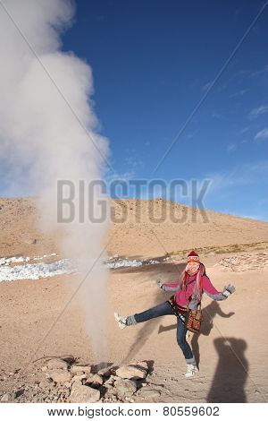 Young woman tourist at the Geyser in Bolivia
