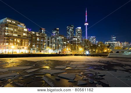 Toronto Skyline in the winter showing frozen water in the lake