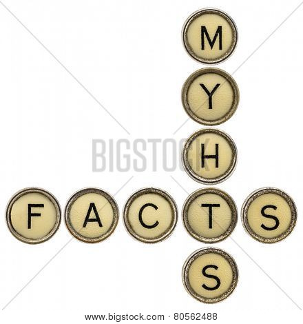 facts and myths  crossword in old round typewriter keys isolated on white