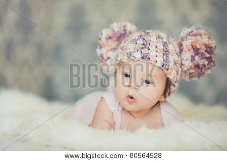 Happy little girl in cap bear