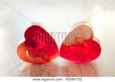 Red Heart Shaped Couple Soup In Rays Of Sunlight.