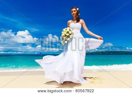 Beautiful Brunette Bride In White Wedding Dress With Big Long White Train And With Wedding Bouquet