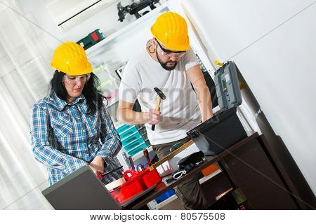 Portrait of male and female workers selective focus