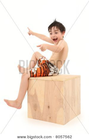 Boy In Swim Suit On Wooden Box