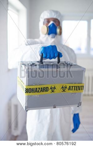 Close-up of medical case with biohazard symbol held by scientist