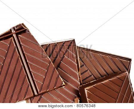 Chopped Chocolate Bar Isolated On White Background. Dark Chocolate Pieces Closeup. Chocolate Pieces,