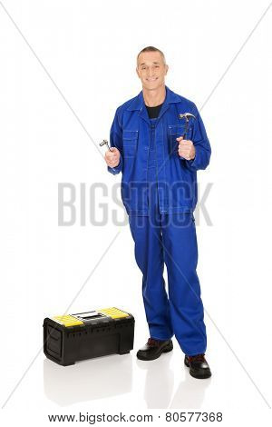Worker with toolbox showing his wrench and hammer.