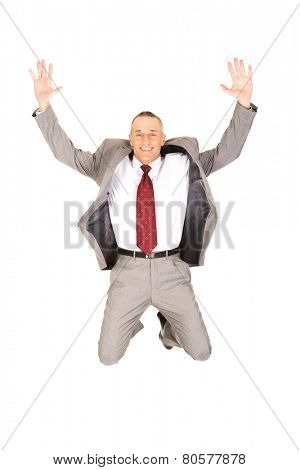 Excited businessman jumping because of success.