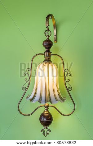 Ancient Vintage Luminaire. On The Green Wall.