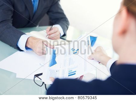 Statistical Business People Analyzing Information Monitoring Concept
