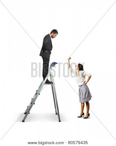displeased woman screaming and showing her fist at businessman on stepladder. isolated on white background
