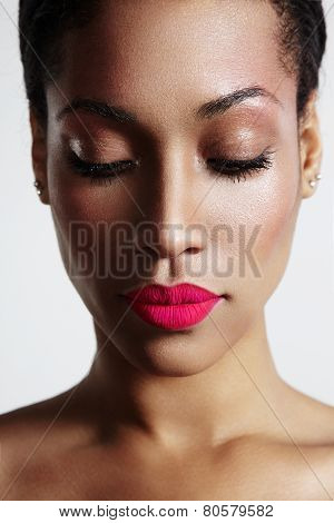 Woman With Ideal Skin And Bright Mate Lips