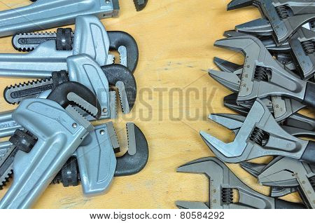 set of hand tools on a wooden background, Wrench tools or Pipe wrench for hard work.