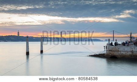 Portugal, Europe - The Columns Wharf Viewpoint at commerce square downtown at sunset in city of Lisbon (panorama-long exposure)