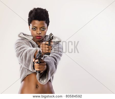 Woman With Two Guns
