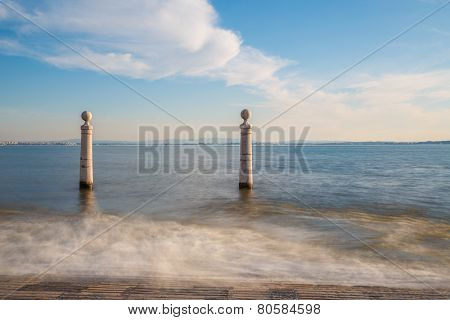 Lisbon, Portugal, Europe - View of the wharf columns in square of commerce (afternoon, long exposure)