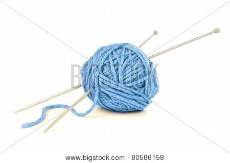 Blue yarn with knitting needles