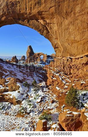Turret Arch Seen Through North Window Arch In Arches National Park, Utah In Winter