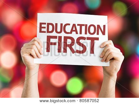 Education First card with colorful background with defocused lights