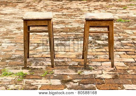 Two Chairs On Red Brick Background