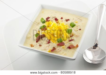 Corn chowder with scallions bacon and grated cheddar