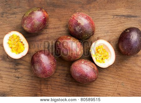 Ripe Passion Fruits On A Wooden Background