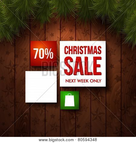 Christmas sale design template. Wooden background, realistic fir