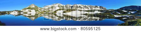 Panoramic View Of Snowy Range Mountains And Alpine Lake With Reflection In Medicine Bow, Wyoming In