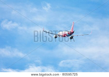 PHUKET, THAILAND- OCTOBER 21, 2013: AirAsia plane takes off from Phuket Airport. AirAsia group operates scheduled domestic and international flights to 100 destinations spanning 22 countries