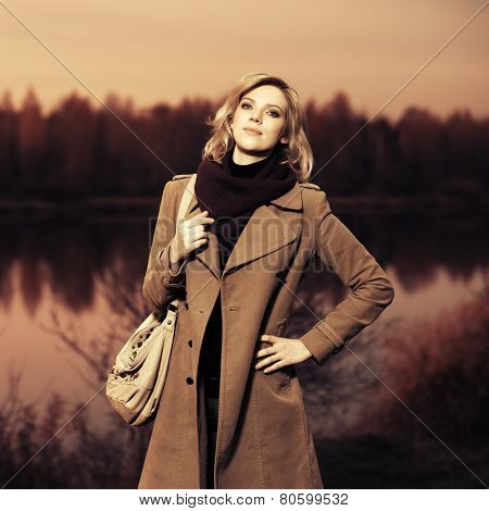 Portrait of young blond fashion woman outdoor