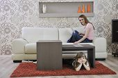 stock photo of youg  - happy youg family relaxing in modern livingroom at home - JPG