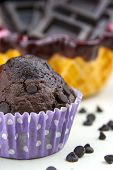 foto of chocolate muffin  - Close up of chocolate muffins on a white table with a lot of chocolate - JPG