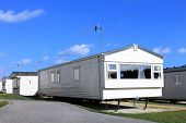 picture of trailer park  - Exterior of a modern caravan on a trailer park in summer - JPG
