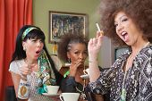 picture of peer-pressure  - Mixed group of 3 women smoking and drinking alcohol - JPG