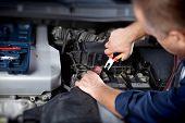 stock photo of auto garage  - Mechanic working in auto repair garage - JPG