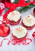 stock photo of red velvet cake  - Decorated red velvet cupcakes on holiday background  - JPG
