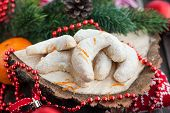 stock photo of crescent-shaped  - Christmas nut crescent cookies on festive background