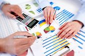 stock photo of financial audit  - Hands of business people working in office with documents - JPG