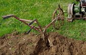foto of plow  - Plowing the soil with electric winch and hand plow - JPG