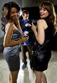 foto of seducing  - women seducing a man at a bar or nightclub - JPG