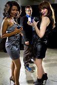 stock photo of seducing  - women seducing a man at a bar or nightclub - JPG