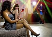 pic of seducing  - women seducing a man at a bar or nightclub - JPG
