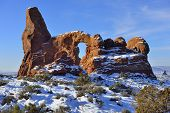 stock photo of arch  - Turret Arch seen through North Window Arch in Arches National Park Utah in winter - JPG