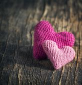 stock photo of two hearts  - Two Crochet Pink Hearts On Wooden Background - JPG